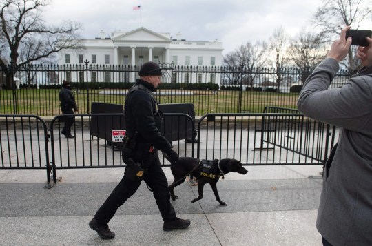 Members of the U.S. Secret Service Division in uniform patrol the White House in Washington, DC, January 9, 2019, the 18th day of the government's partial closure.