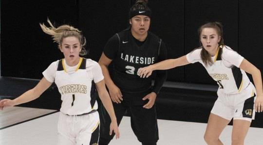 Gilbert High School basketball players Haley Cavinder, on left and her twin sister Hanna Cavinder on far right, defends Lakeside Jolene Armendariz during the Nike Tournament of Champions in Phoenix, Az.