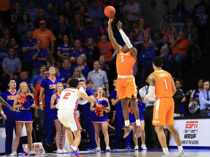 Tennessee guard Admiral Schofield (5) makes a 3-pointer over Florida guard Andrew Nembhard (2) in the final minute on Jan. 12, 2019.