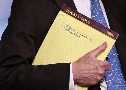 With handwritten notes visible on a legal pad, National Security Adviser John Bolton listens to questions from reporters during a press briefing at the White House Jan. 28, 2019, in Washington, D.C.