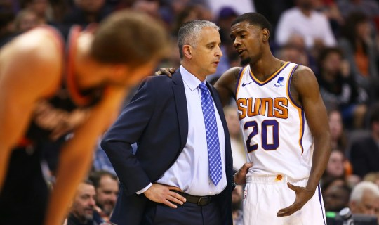 Suns coach Igor Kokoskov talks with forward Josh Jackson during the first half of a game against the Trail Blazers on Jan. 24 at Talking Stick Resort Arena.