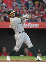 Athletics left fielder Khris Davis  watches his two-run home run clear the fence during a game against the Angels at Angel Stadium of Anaheim.