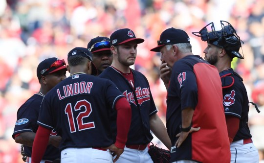 Indians pitching coach Carl Willis talks with starting pitcher Trevor Bauer during Game 3 of an American League division series against the Astros..