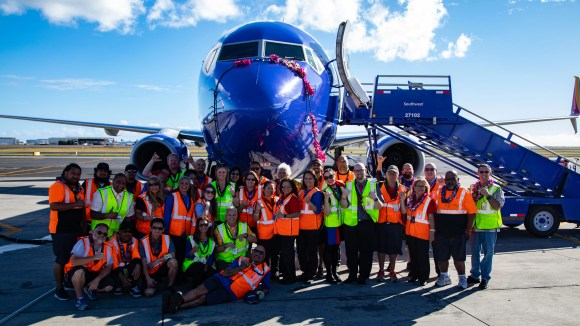 A Southwest Airlines Boeing 737-800 is seen in Honolulu with celebrating employees after the first landing of the courier on the Hawaiian Islands on February 5, 2019. The flight was part of a certification needed to start the passenger service.