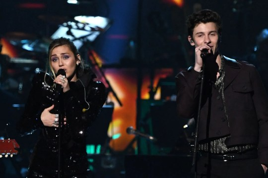 Miley Cyrus and Shawn Mendes perform onstage at the 2019 MusiCares Person Of The Year gala.