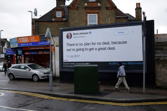 "A billboard is displayed in north London on Feb. 8, 2019, as part of the ""Led By Donkeys"" campaign that aims to highlight misleading statements made about Brexit made by politicians."