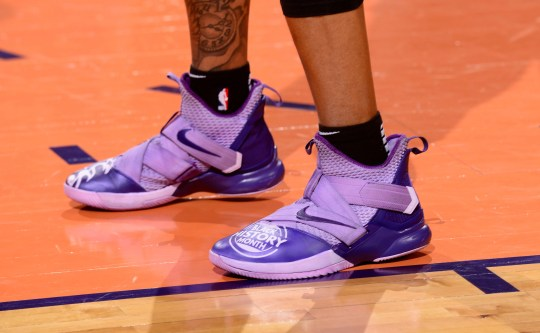 Richaun Holmes wearing purple-on-purple Nike sneakers tied to Black History Month.