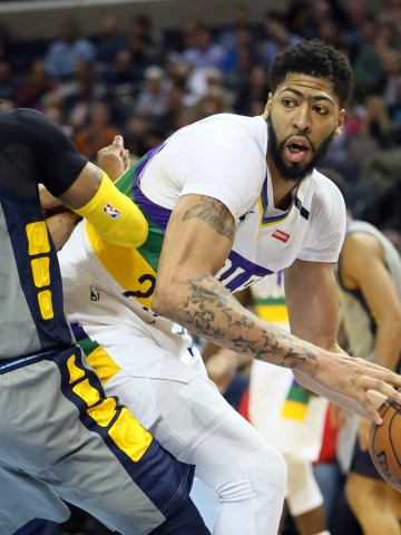 Anthony Davis remains with the New Orleans Pelicans after trade talks with the Los Angeles Lakers didn't pan out.