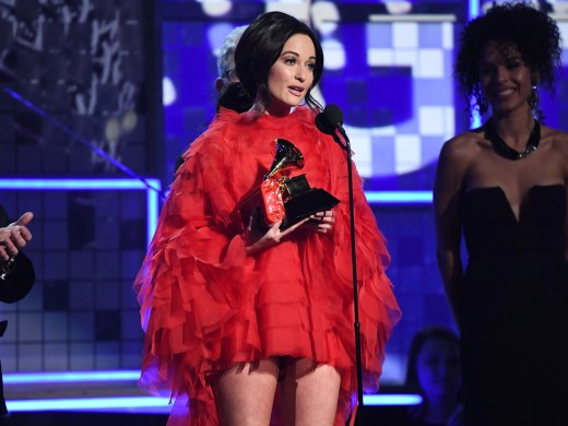"""Kacey Musgraves accepts the award for album of the year for """"Golden Hour."""""""