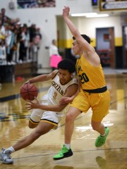 Galena's Isaiah Duve drives to the basket with Manogue's Cort Ballinger covering him in Tuesday's game at Galena.