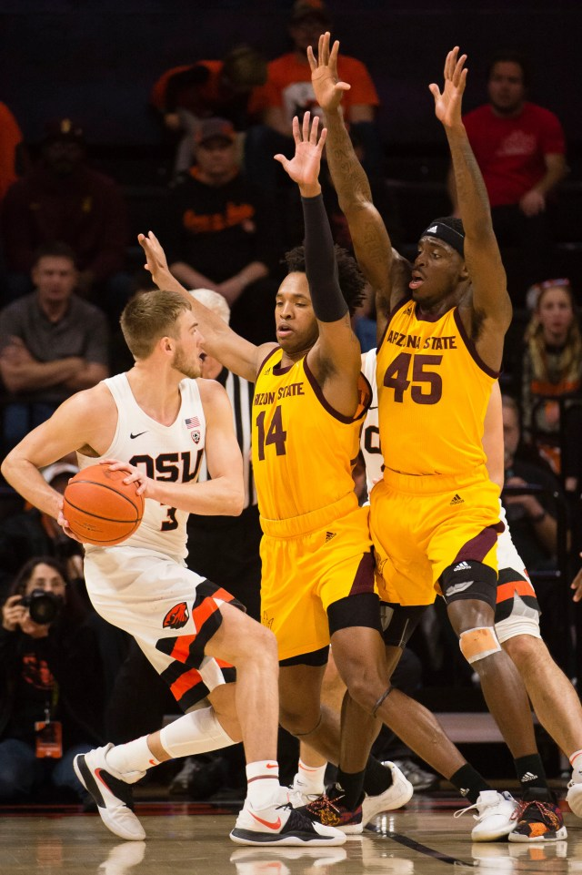 Mar 3, 2019; Corvallis, OR, USA; Oregon State Beavers forward Tres Tinkle (3) controls the ball defended by Arizona State Sun Devils forward Kimani Lawrence (14) and forward Zylan Cheatham (45) during the first half at Gill Coliseum.