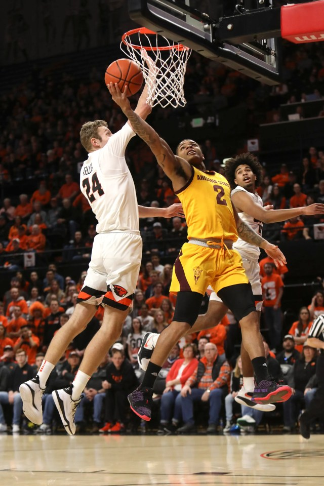 Arizona State's Rob Edwards (2) gets past a block by Oregon State's Kylor Kelley (24) during the first half of an NCAA college basketball game in Corvallis, Ore., Sunday, March 3, 2019.