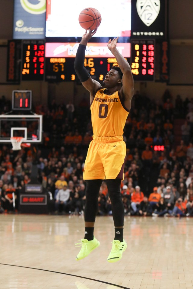 Arizona State's Luguentz Dort (0) hits a three-point basket in the last minute of play during the second half of an NCAA college basketball game against Oregon State in Corvallis, Ore., Sunday, March 3, 2019. Arizona State won 74-71.