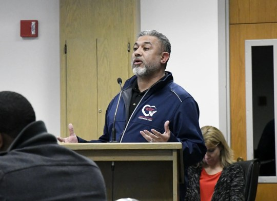 Crestwood Elementary Kindergarten teacher Raul Gonzalez speaks to board members at the Visalia Unified special board meeting at the district office on Thursday, March 7, 2019.
