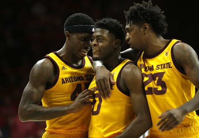 ASU's Romello White (23) and Zylan Cheatham (45) grab Luguentz Dort (0) after he was called for a technical foul during the first half at the McKale Memorial Center in Tucson, Ariz. on March 9, 2019.