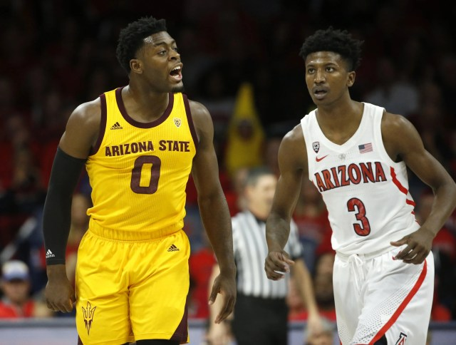 ASU's Luguentz Dort (0) yells at Arizona's Dylan Smith (3) drawing a technical foul during the first half at the McKale Memorial Center in Tucson, Ariz. on March 9, 2019.