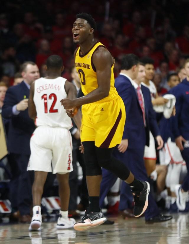 ASU's Luguentz Dort (0) celebrates a dunk against Arizona during the second half at the McKale Memorial Center in Tucson, Ariz. on March 9, 2019.