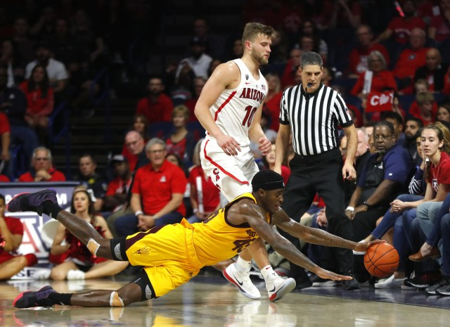 ASU's Zylan Cheatham (45) dives for a loose ball against Arizona's Ryan Luther (10) during the second half at the McKale Memorial Center in Tucson, Ariz. on March 9, 2019.