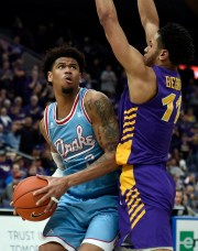 Mar 9, 2019; St. Louis, MO, United States; Northern Iowa Panthers guard Trae Berhow (11) defends against Drake Bulldogs forward Tremell Murphy (2) during the second half in the Missouri Valley Conference Tournament at Enterprise Center.