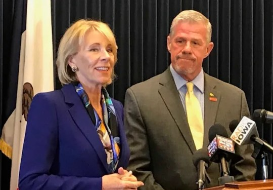 U.S. Secretary of Education Betsy DeVos visited Des Moines Friday to host a closed-door roundtable on a proposal that would give dollar-for-dollar tax credits for donations to groups that provide scholarships to private schools. Rep. Brad Zaun, R-Urbandale, (right) supports the