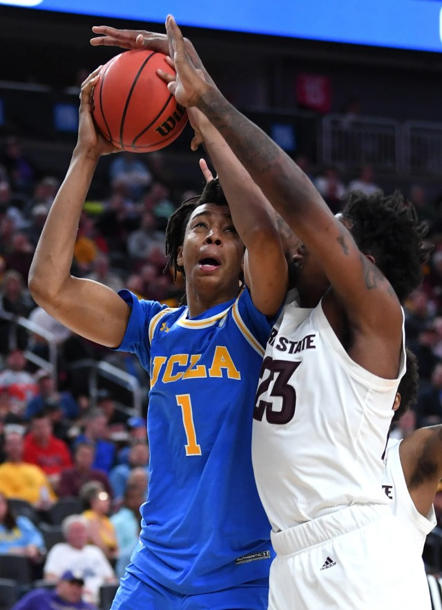 Mar 14, 2019; Las Vegas, NV, United States; UCLA Bruins center Moses Brown (1) shoots against Arizona State Sun Devils forward Romello White (23) during the second half of a Pac-12 conference tournament game at T-Mobile Arena.