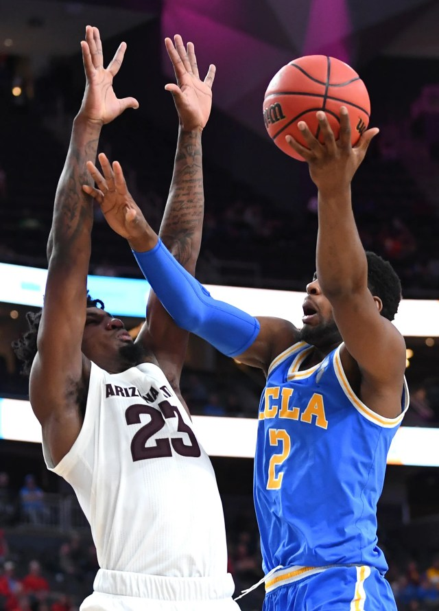 Mar 14, 2019; Las Vegas, NV, United States; UCLA Bruins forward Cody Riley (2) shoots against Arizona State Sun Devils forward Romello White (23) during the second half of a  Pac-12 conference tournament game at T-Mobile Arena.