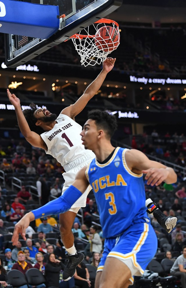 Mar 14, 2019; Las Vegas, NV, United States; Arizona State Sun Devils guard Remy Martin (1) dunks inside the defense of UCLA Bruins guard Jules Bernard (3) during the first half of as Pac-12 conference tournament game at T-Mobile Arena.