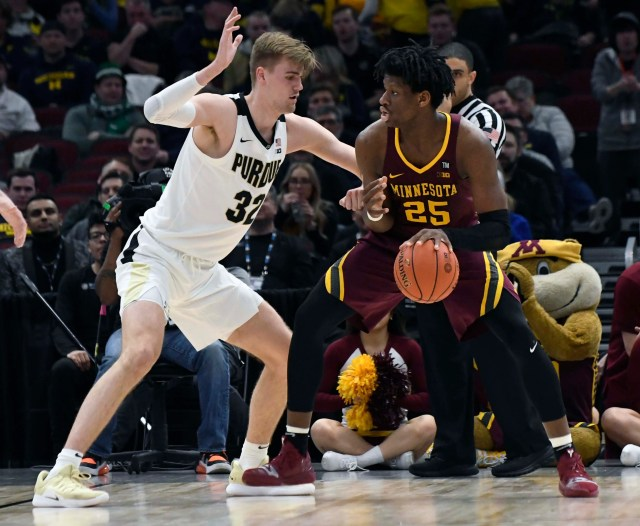 Mar 15, 2019; Chicago, IL, USA; Minnesota Golden Gophers center Daniel Oturu (25) is defended by Purdue Boilermakers center Matt Haarms (32) during the second half in the Big Ten conference tournament at United Center. Mandatory Credit: David Banks-USA TODAY Sports