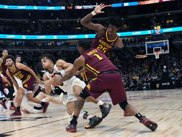 Mar 15, 2019; Chicago, IL, USA; Purdue Boilermakers guard Carsen Edwards (3) is defended by Minnesota Golden Gophers guard Dupree McBrayer (1) and center Daniel Oturu (25) during the second half in the Big Ten conference tournament at United Center. Mandatory Credit: David Banks-USA TODAY Sports