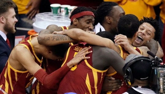 Iowa State guard Lindell Wigginton, right, celebrates with teammates following an NCAA college basketball game in the final of the Big 12 conference tournament in Kansas City, Mo., Saturday, March 16, 2019. Iowa State defeated Kansas 78-66. (AP Photo/Orlin Wagner)