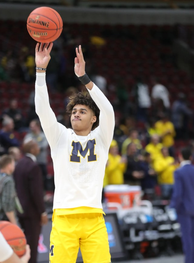 Michigan's Jordan Poole warms up before the Big Ten tournament championship against Michigan State, Sunday, March 17, 2019 at the United Center in Chicago.