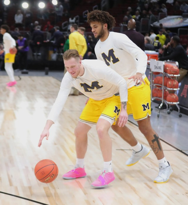 Michigan forwards Ignas Brazdeikis, bottom, and Isaiah Livers warm up before the Big Ten tournament championship against Michigan State, Sunday, March 17, 2019 at the United Center in Chicago.