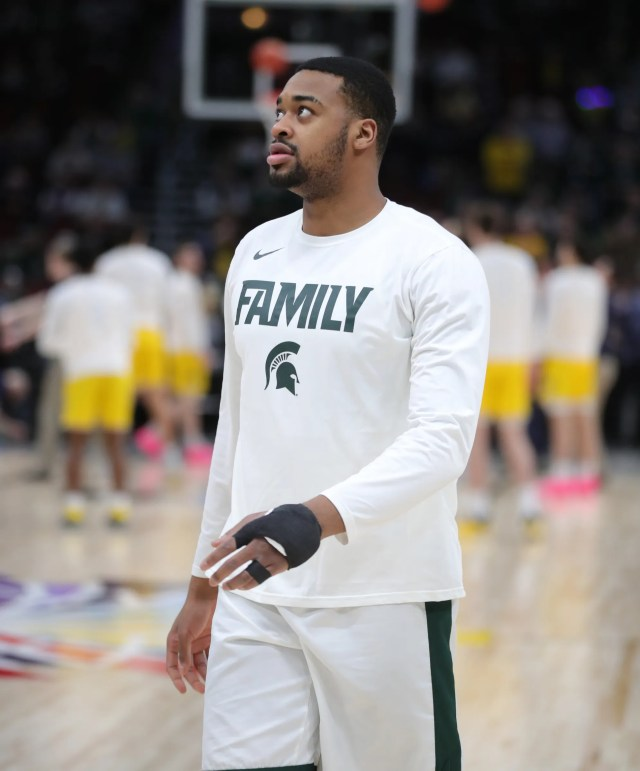 Michigan State's Nick Ward warms up before the Big Ten tournament championship against Michigan, Sunday, March 17, 2019 at the United Center in Chicago.