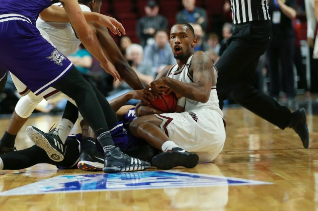 Mar 15, 2019; Boise, ID, USA; Montana Grizzlies guard Sayeed Pridgett (4) and Montana Grizzlies guard Kendal Manuel (12) battle for loose ball during the second half of the Big Sky Conference Mens Basketball Tournament  at CenturyLink Arena. Montana defeats Weber State 78-49.
