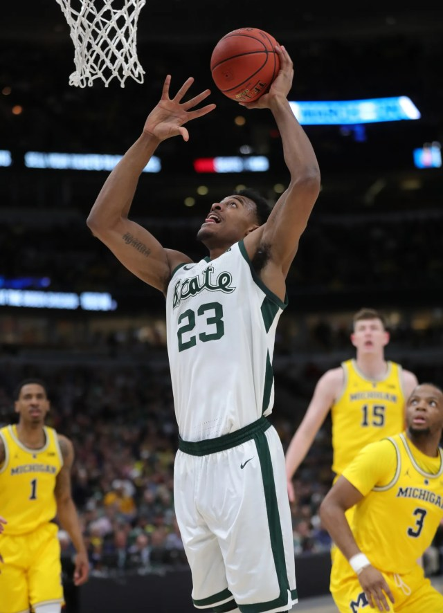 Michigan State forward Xavier Tillman scores against Michigan during the first half of the Big Ten tournament championship Sunday, March 17, 2019 at the United Center in Chicago.