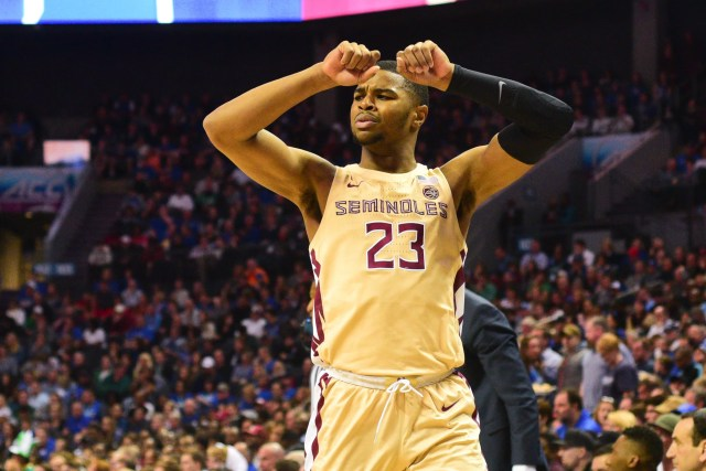 Sophomore guard M.J. Walker flexes as Florida State led Duke during the first half of the ACC Championship game at the Spectrum Center on Saturday.