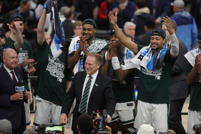 Michigan State coach Tom Izzo accepts the Big Ten tournament championship trophy after defeating Michigan, 65-60, Sunday, March 17, 2019 in Chicago.