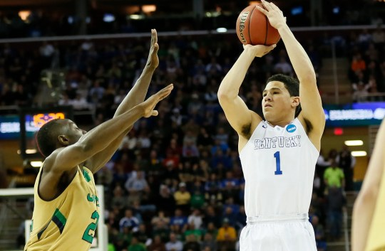 Wildcats guard Devin Booker (1) shoots over Notre Dame guard Jerian Grant (22) during the first half of an NCAA Tournament game in 2015.