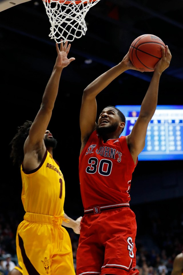 Mar 20, 2019; Dayton, OH, USA; St. John's Red Storm guard LJ Figueroa (30) goes to the basket defended by Arizona State Sun Devils guard Remy Martin (1) in the first half in the First Four of the 2019 NCAA Tournament at Dayton Arena. Mandatory Credit: Rick Osentoski-USA TODAY Sports