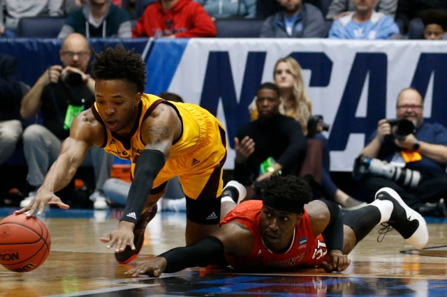 Mar 20, 2019; Dayton, OH, USA; Arizona State Sun Devils forward Kimani Lawrence (14) and St. John's Red Storm forward Sedee Keita (0) dive for the ball in the first half in the First Four of the 2019 NCAA Tournament at Dayton Arena. Mandatory Credit: Brian Spurlock-USA TODAY Sports