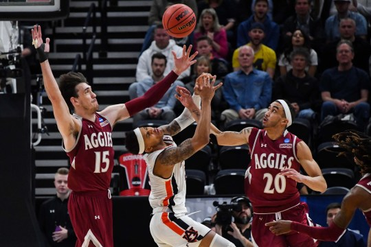 Auburn Tigers guard Bryce Brown (2) reacts as the ball goes loose with New Mexico State Aggies forward Ivan Aurrecoechea (15) and guard Trevelin Queen (20).