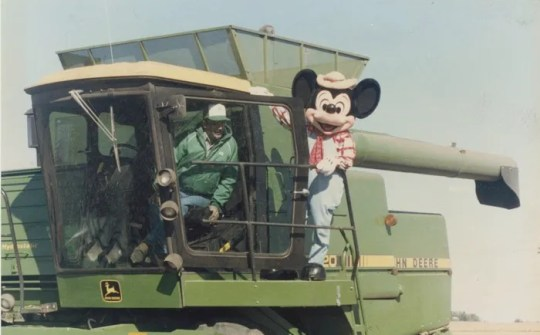 Mickey Mouse joined Joe Pitzenberger in combining corn from a field near Dougherty, Iowa, in the fall of 1988. The Pitzenbergers were commissioned that year by the Walt Disney Company to plant corn and oats in the shape of Mickey Mouse to honor the character's 60th birthday. The 520-acre field became a sensation as air travelers could see