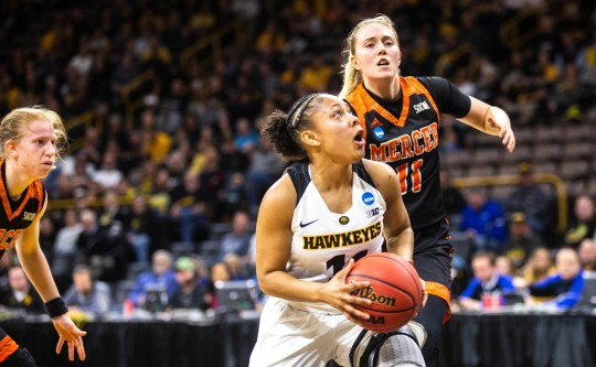 Iowa guard Tania Davis (11) drives to the basket against Mercer guard Linnea Rosendal (11) during a NCAA women's basketball tournament first-round game, Friday, March 22, 2019, at Carver-Hawkeye Arena in Iowa City, Iowa.