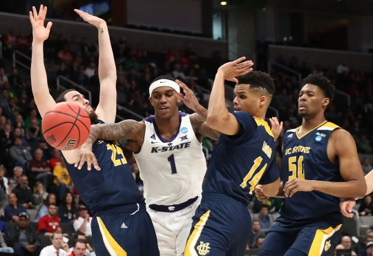 UC Irvine's Spencer Rivers, Kansas State's Shaun Neal-Williams and UCIrvine's Evan Leonard and Elston Jones battle for a loose ball in the first half.