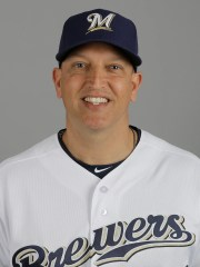 Milwaukee Brewers hits coach Andy Haines.