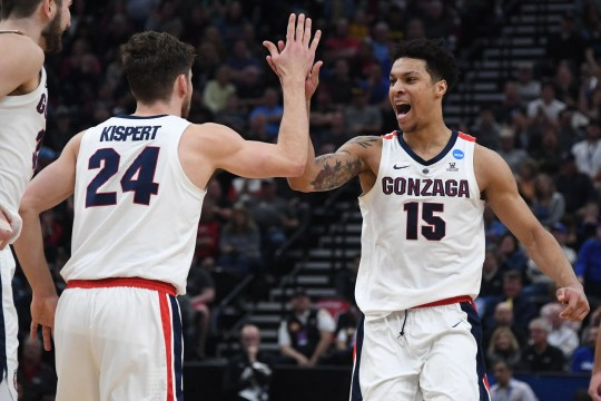 Gonzaga Bulldog striker Brandon Clarke (15) reacts with striker Corey Kispert (24) in the first half of the NCAA 2019 second round against the Baylor Bears at the Vivint Smart Home Arena.