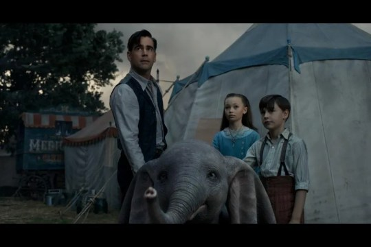 "Holt Farrier (Colin Farrell, left) and his children, Milly (Nico Parker) and Joe (Finley Hobbins), get protective of a baby elephant in ""Dumbo."""