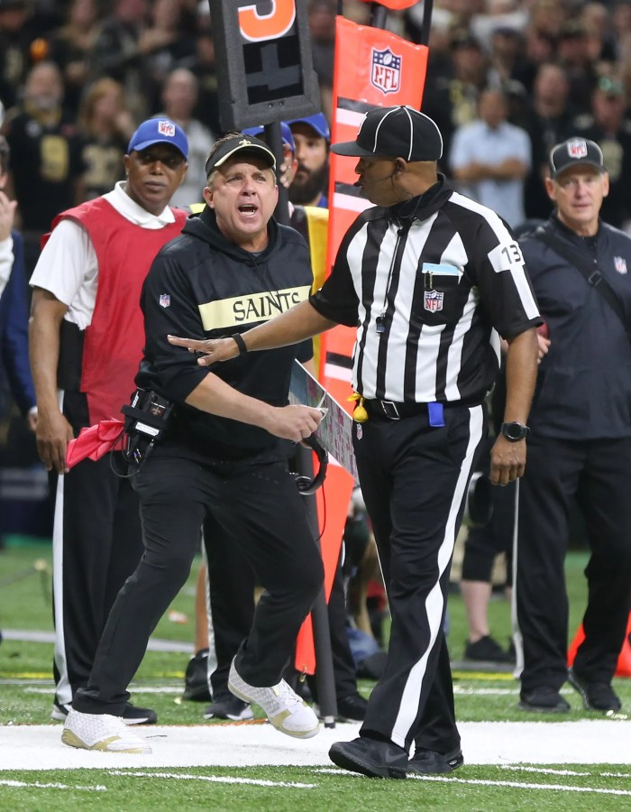 New Orleans Saints head coach Sean Payton reacts after a pass play against the Los Angeles Rams during the fourth quarter of the NFC Championship game at Mercedes-Benz Superdome.