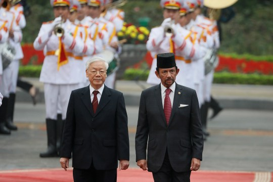 Sultan Haji Hassanal Bolkiah of Brunei, right, and Vietnam's President Nguyen Phu Trong review an honor guard during a welcoming ceremony at the Presidential Palace in Hanoi, Vietnam on March 27, 2019.
