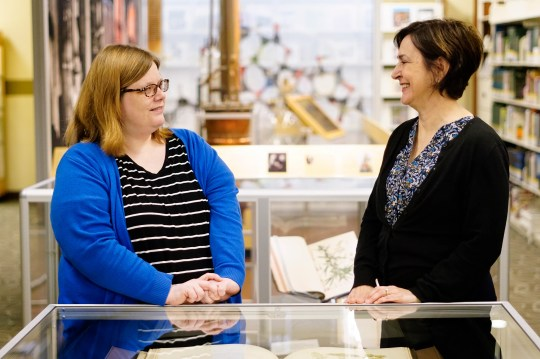 "From left, Erin Campbell, a reference librarian, and Patricia Van Skaik, the executive director of the Lloyd Library and Museum, which currently features ""Through the Rx Bottle,"" a history of medicinal cannabis"